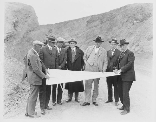 Harry Chandler and others inspect plans for Mulholland Dam, circa 1920