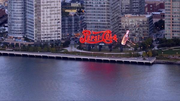 Enseigne Pepsi Cola depuis l'Empire State Building au coucher du soleil